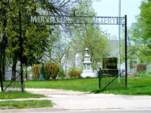 A gated entrance to a cemetery