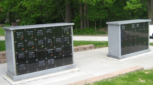 2 columbariums in a wooded area of a city cemetery