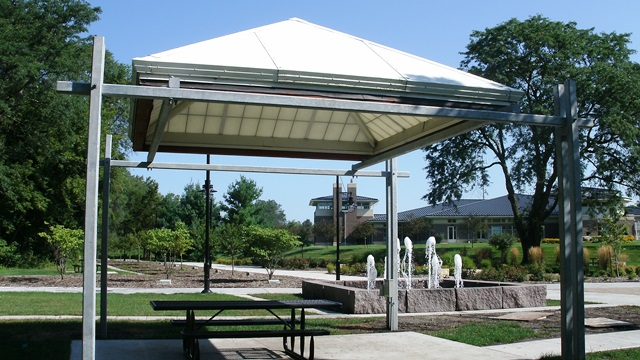 A picnic shelter and picnic table in a city park