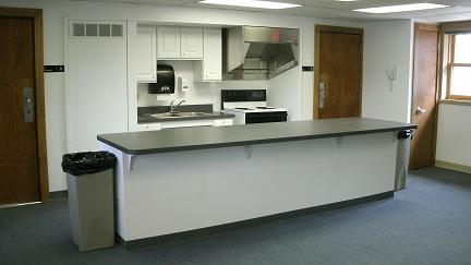 A kitchenette area of an indoor rental facility