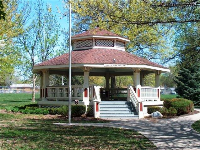 A gazebo in a wooded area of a city park