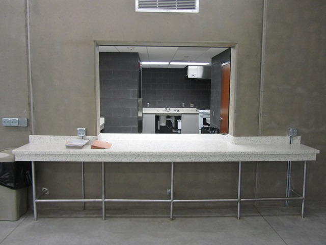 A kitchen area of an indoor community facility