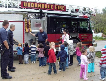 Children Gather Around a Fire Truck