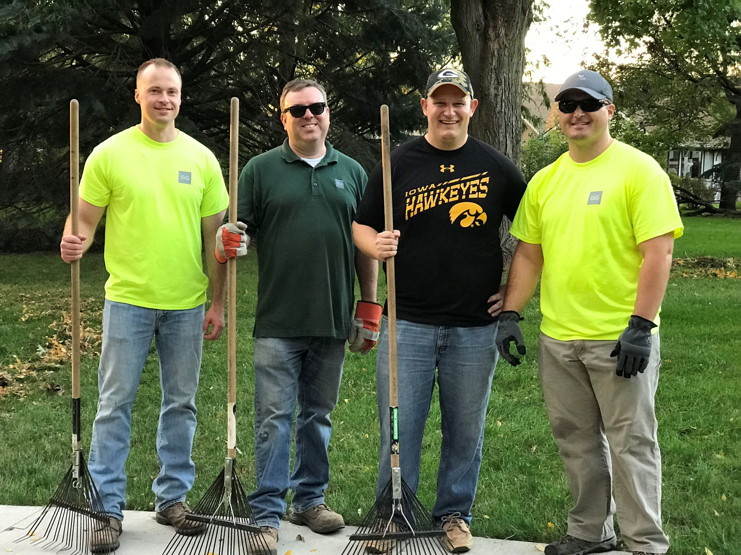 Four Men Help Clean Up Park