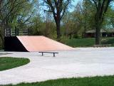A cement ramp feature at a city skateboard park
