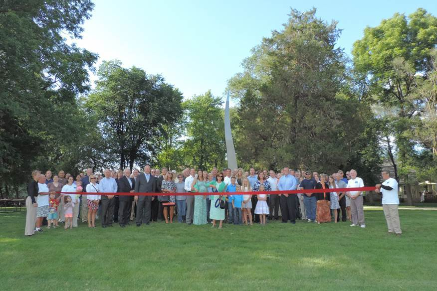 Photo of the ribbon cutting event for the public art piece, the Beacon of Hope