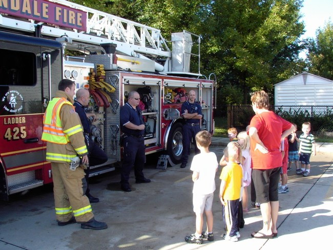 Children learn about the fire truck