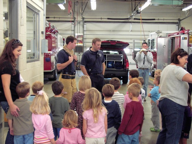 A group of children in the fire station