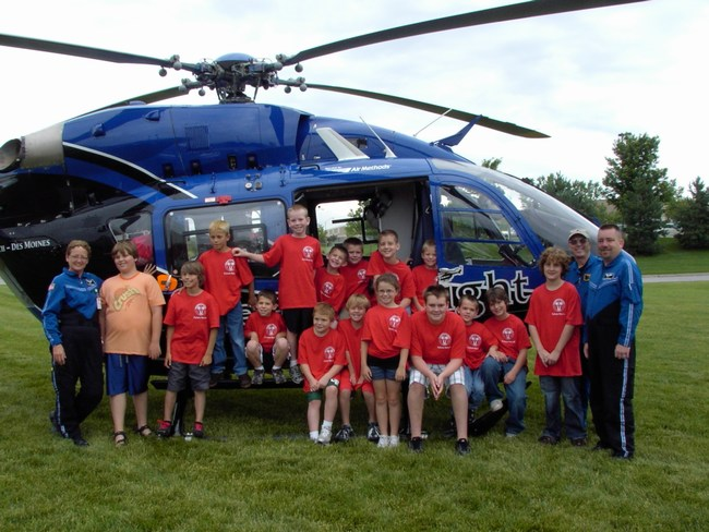 Children pose with the helicopter crew