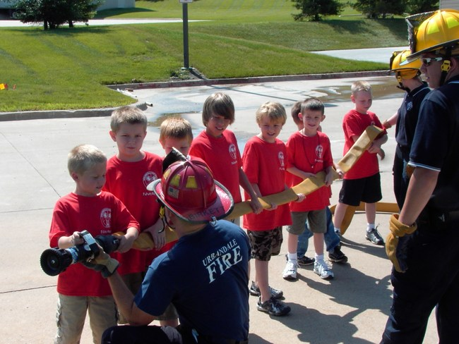 Children hold the fire hose