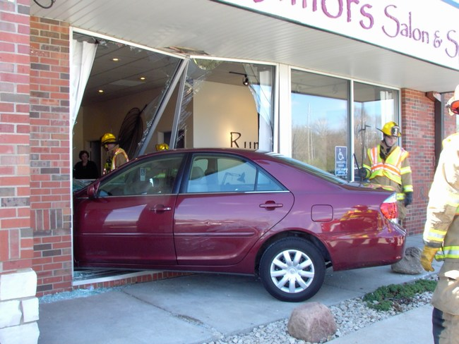 A car has gone through the front of a shop