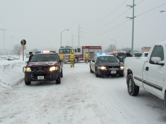 Emergency responders help people stuck on snow covered roads