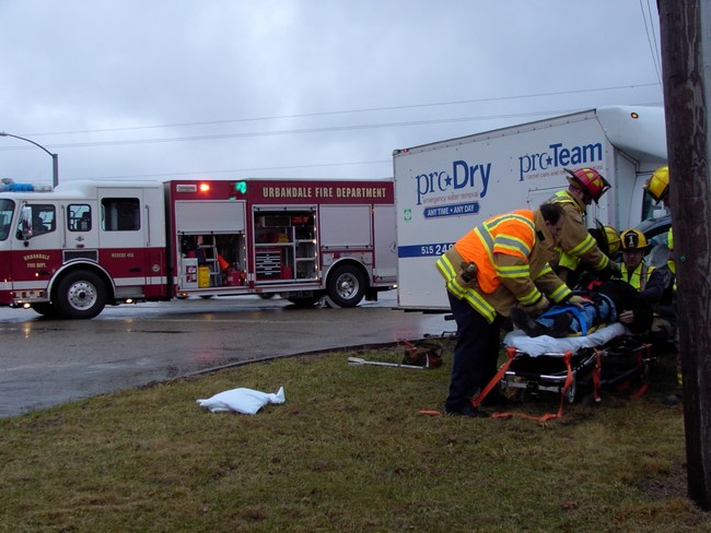 Emergency responders assist a victim