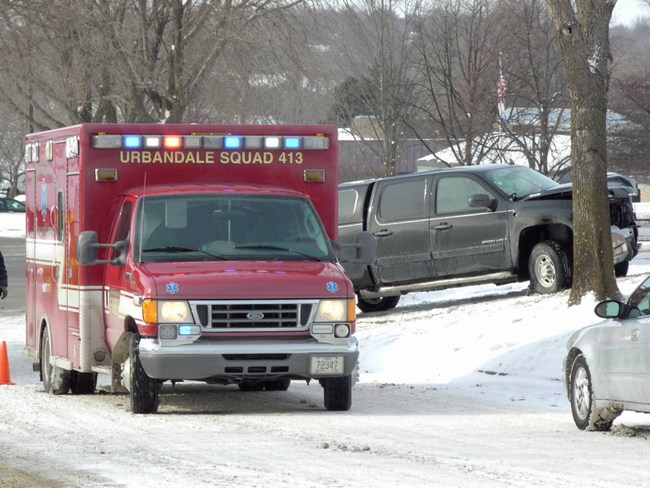 An ambulance responds to an accident on snowy roads