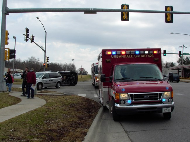An ambulance and a fire truck on the scene of an accident