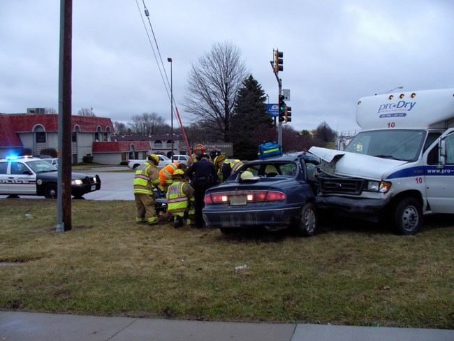 Emergency workers respond to a collision between a car and a bus