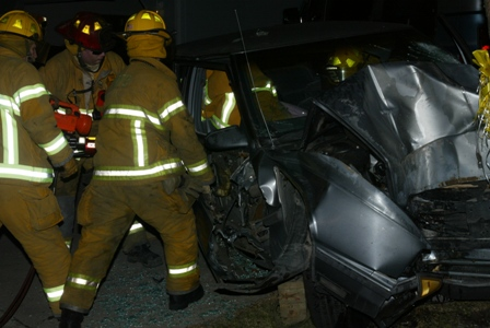 "Firefighters use the ""Jaws of Life"" to rescue someone from a mangled car"
