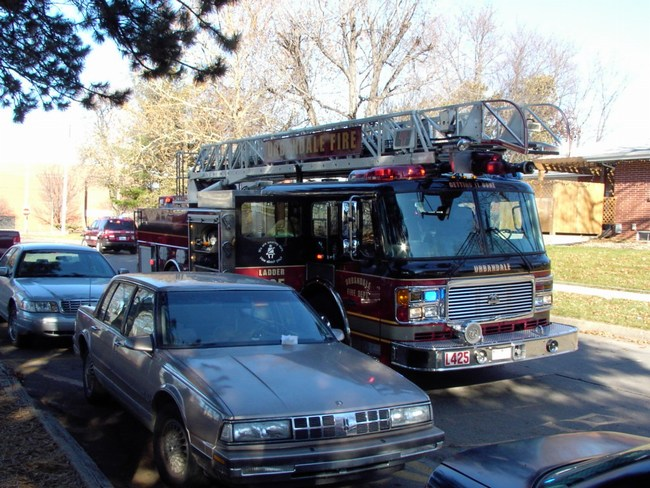 Ladder 425 responds to a house fire