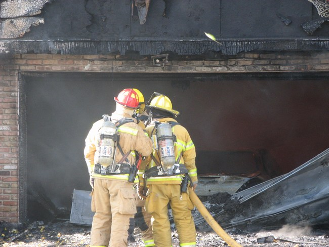 Firefighters talk about how to best attack the fire