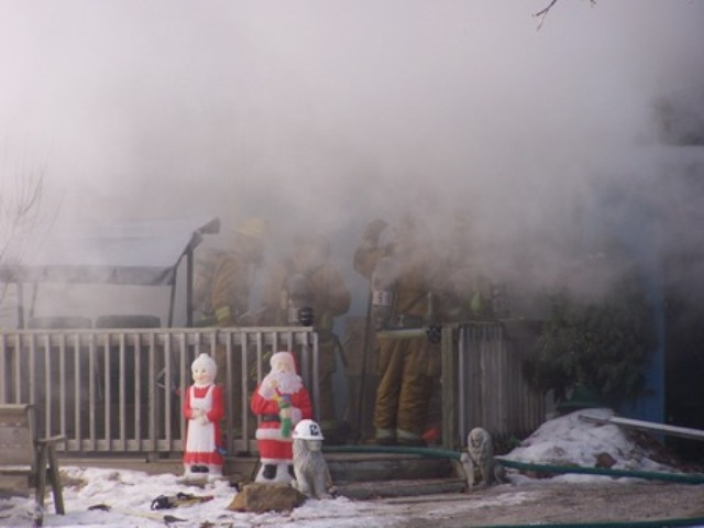 Fire strikes even during the holidays as Mr. and Mrs. Clause stand outside a house fire