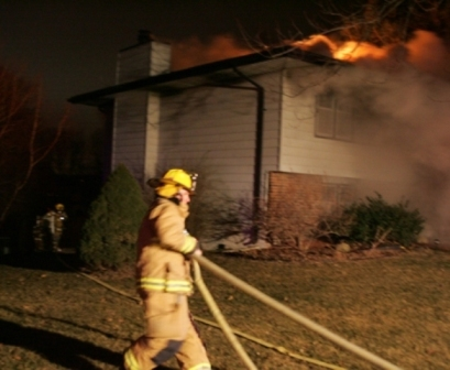 Firefighters fight a fire late at night