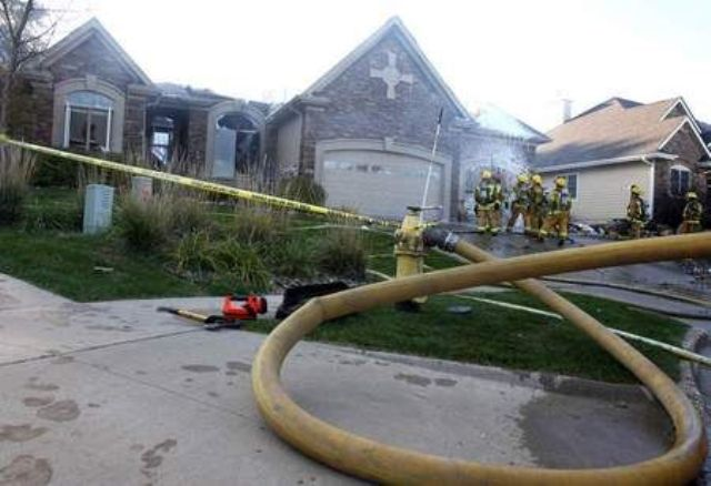 Firefighters put out a fire in a brick home