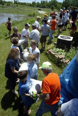 People move sand bags as a human conveyor belt