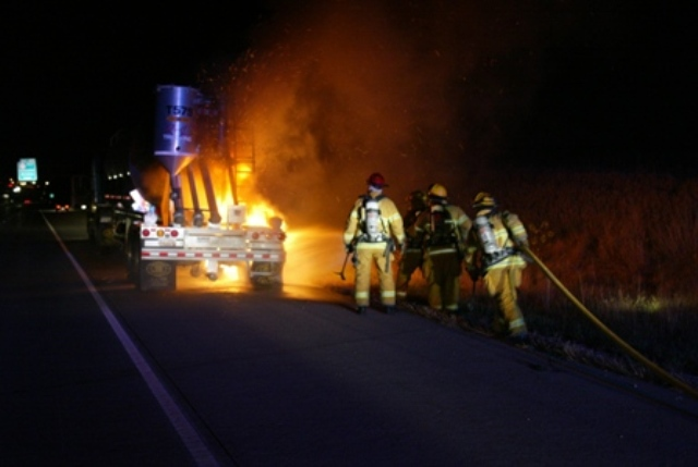 Firefighters fight a fire on a tractor trailer