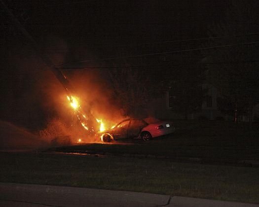 A car is damaged by fire