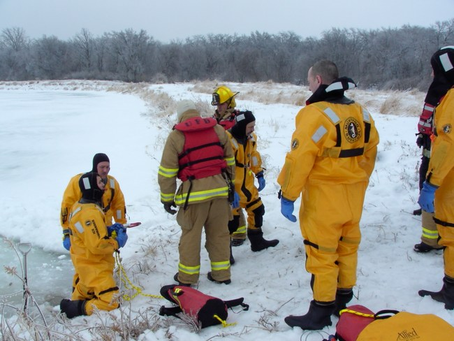Firefighters get ready for a training exercise on the ice