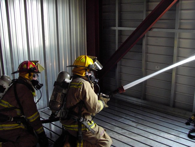 Firefighters use the hose inside