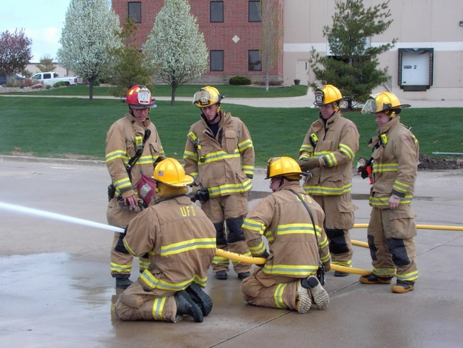 Firefighters learn proper techniques for using a fire hose